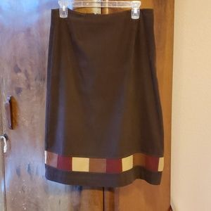 A knee length skirt with square pattern suede